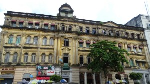A grand but dilapidated building in central Yangon
